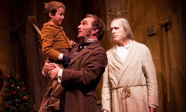 pictured in charles dickens a christmas carol directed by william brown are l to r john babbo tiny tim ron rains bob cratchit and larry yando - Christmas Carol 2009